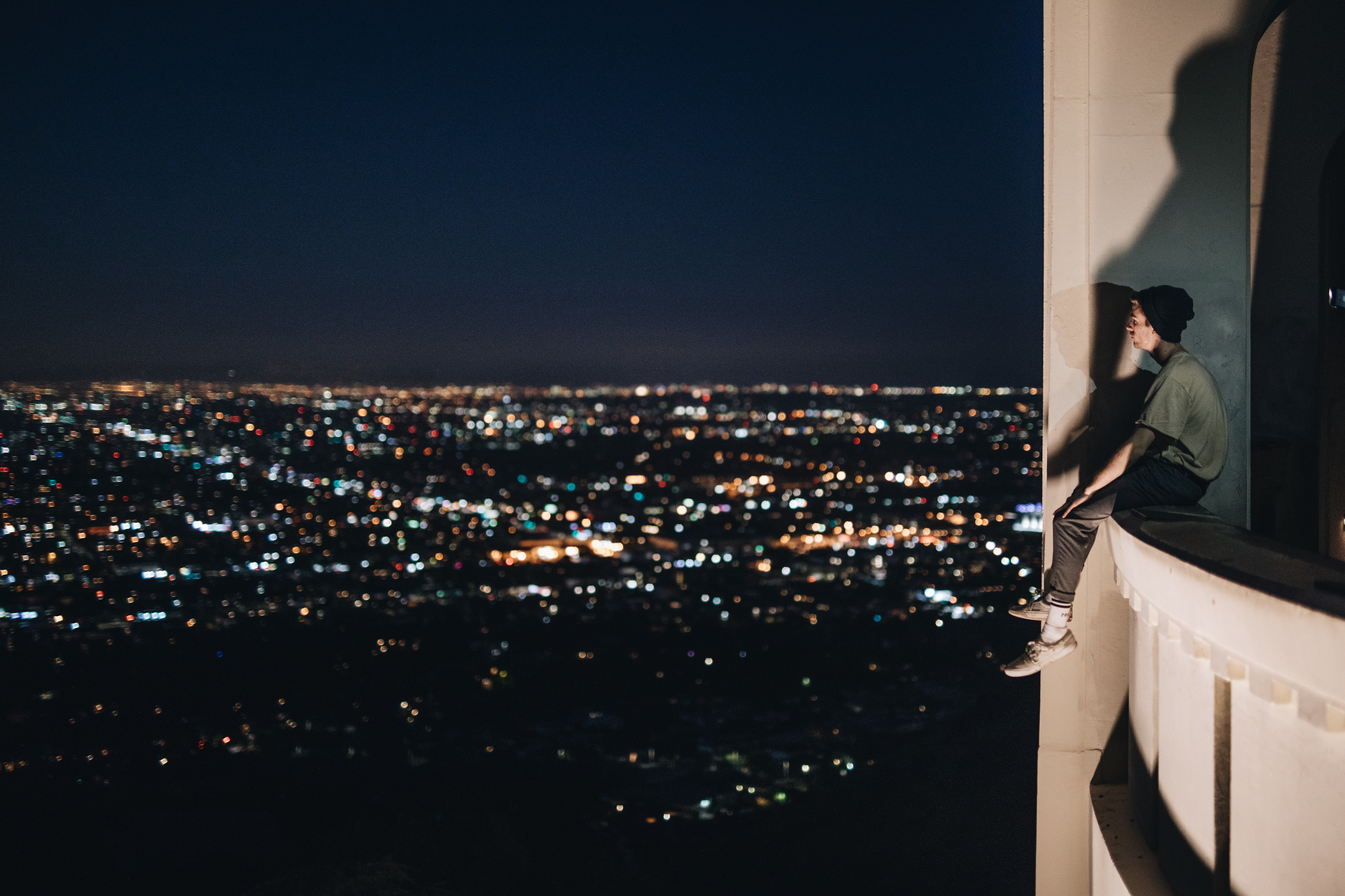 High risk - man on a ledge looking over a city - Petros, Resilience for life